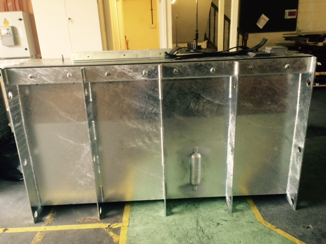 Flood barrier fully assembled with basin housing